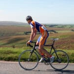 Cyclist riding in the sunshine through Exmoor National Park