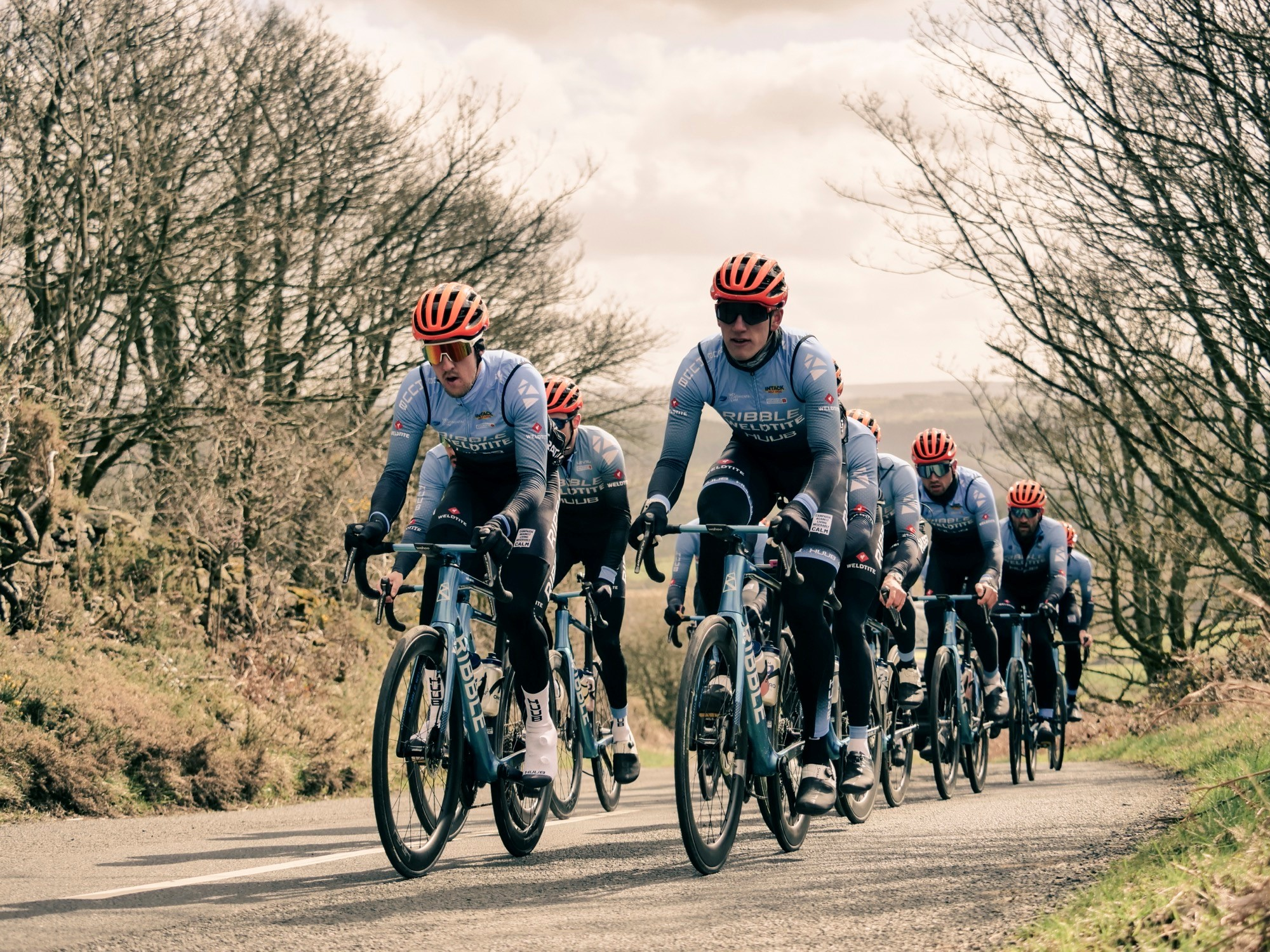 Photo of Freddie riding with his Ribble Weldtite teammates