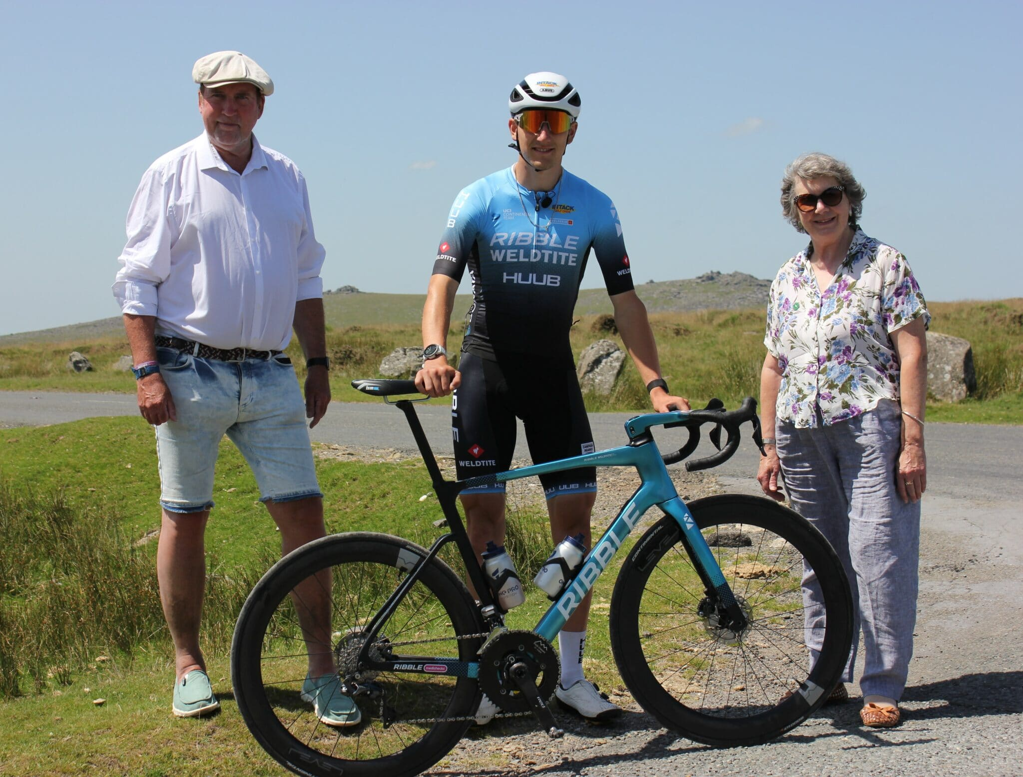 Photo of pro cyclist Freddie Scheske and councillors on Dartmoor