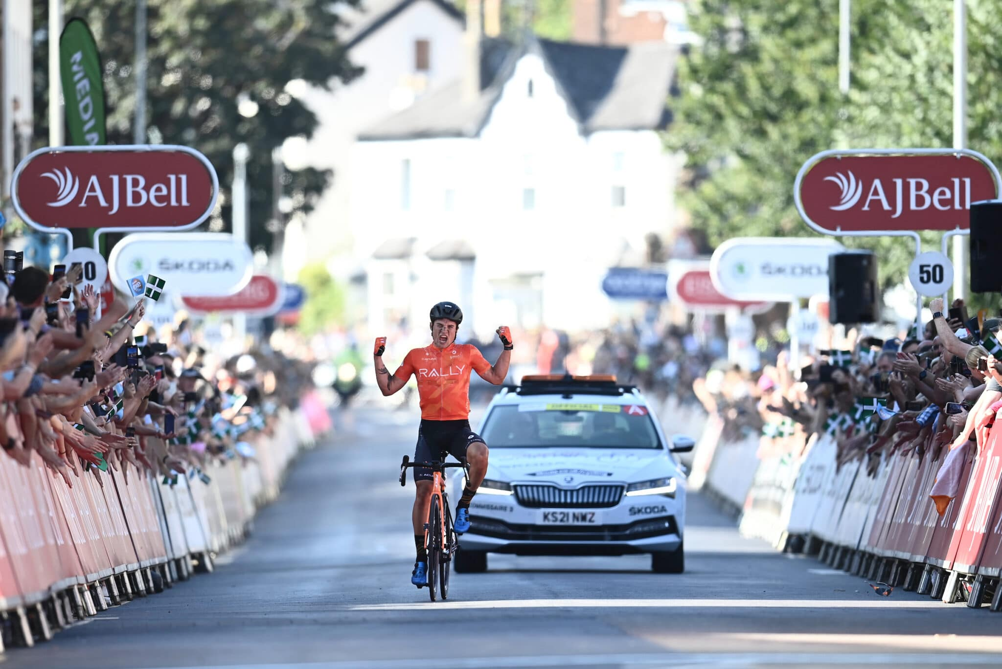 Photo of Robin Carpenter crossing the finish line in Exeter